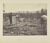 Man holding bent rail