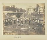 Railroad construction workers straightening rails