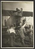 Soldiers loading supplies in plane
