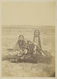 Arapaho Chief Powder Face, his wife, and Their Son