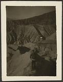 Figure in Rocky Desert Landscape