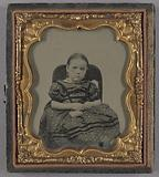 Portrait of a seated Little Girl holding small Purse