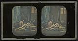 Two nudes in boudoir studio setting