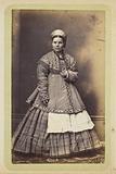 Woman wearing embroidered jacket and kokoshnik