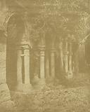 Ruins of arches covered in foliage