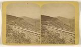 West Side of Dump Mountain, Looking East. Grade, 211 2-10 feet per mile. Spanish Peaks in the Distance.
