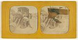 Men loading barrels on a train