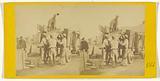 Men loading sheet metal on a truck