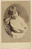 Unidentified little girl with hand on head, printed in oval style