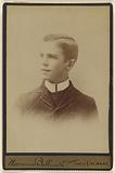 Portrait of a young man with high white collar shirt