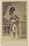 Unidentified soldier in kilt and feathered bonnet