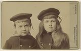 Two unidentified children, a boy and a girl, in sailor suits and sailor hats