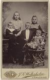 Five children in a studio setting