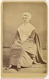 Unidentified woman wearing a bonnet and shawl, seated