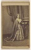 Unidentified woman wearing a tiara and cape, standing