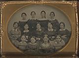 Group portrait of thirteen young women