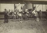 Men grouped in front of a Caproni Ca. 3 airplane.