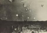 Bombs over low buildings