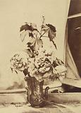 Flowers with Branch of Leaves in Decorative Vase