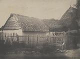 Thatched-roof Building with Border Fence