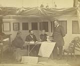 Chinese interpreters with Secretary Drew and Minister low in Cabin of the US Flag Ship Colourado