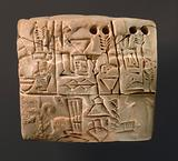 Proto-Cuneiform tablet with seal impressions: administrative account of barley distribution with cylinder seal …