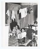 Negro family living in crowded quarters, Chicago, Illinois, April 1941