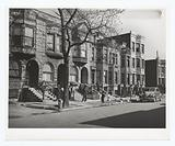 Old brown stonehouses now occupied by Negroes in Chicago, Illinois, April 1941