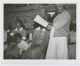 Star pupil, 82 years old, reading her lesson in adult class, Gee's Bend, Alabama, May 1939