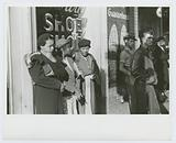 Domestic servants waiting for street car on way early in the morning, Mitchell Street, Atlanta, Georgia, May 1939