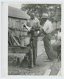 An FSA [Farm Security Administration] supervisor consults a borrower about unsanitary water supply