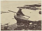 Esquimaux in his kayak ready for seal-hunting
