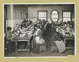 Uncle Sam, host, Immigrants being served a free meal at Ellis Island