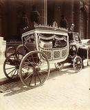 1st class tank, old sedan used as hearse, funeral directors