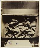 Bas-relief of Mercy, An architect (identifiable by his instruments, the set square and the compass) and his assistant, …