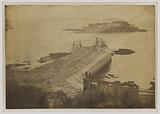 Guernsey, the dike leading to Cornet castle, under construction on the port