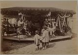 Children watching adults in a carousel
