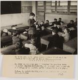 Propaganda photograph: schoolboy reading his letter to a worker in Germany in class