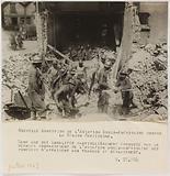 Propaganda photograph: firefighters in the rubble following a bombing, Île de France