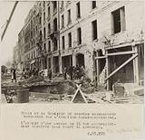 Propaganda photograph: residents clearing the ruins of an avenue in the 16th arrondissement after a bombardment, Paris