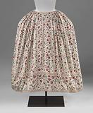 White cotton skirt with vertical stripes and a wide bottom edge of trimmed multi-coloured flower and leaf tendrils, …