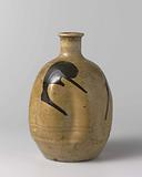 Ovoid sake bottle with a yellow glaze and brown marks