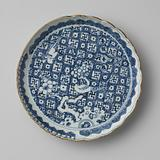 Saucer-dish with two pheasants on a prunus tree on a ground of flowers and swastikas