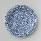 Plate with fluted sides and continuous flower pattern