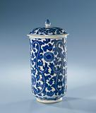 Covered cylindrical beaker with leaf-motif