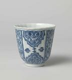Cup with scalloped rim and panel decoration with large lappets