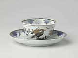Bell-shaped cup and saucer with two pheasants on a rock in a leaf-shaped panel