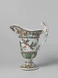 Helmet-shaped ewer with a face, animals and flower sprays