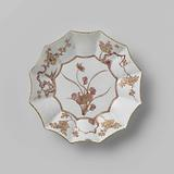 Saucer with a flowering plant in a scalloped medallion and four prunus sprays