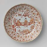 Saucer-dish with two ladies beneath a prunus in a fenced garden